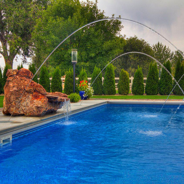 Square pool with rock displays and dramatic fountains.